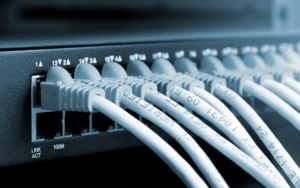 Close up view of server ports with network cables